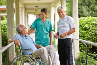 caregiver and two elderly man